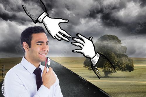 Composite image of smiling businessman holding glasses