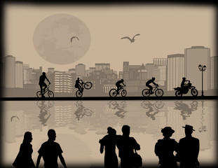 Beautiful cityscape, bikers and couple silhouette