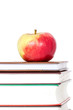 Stack of books with red apple on top