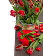 tulip flowers in pot with heart gift box