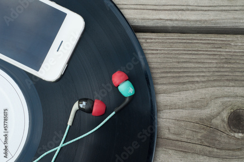 Color Headphones, phone and vinyl on wooden floor