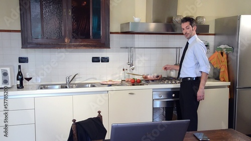 businessman cooking and answering the phone