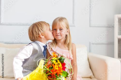 Boy is kissing girl.