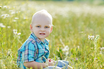 boy in green grass