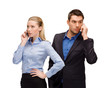 woman and man with cell phones calling