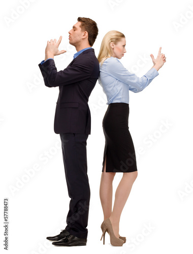businesswoman and businessman with imaginary guns