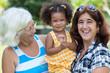 Hispanic grandma, mother and small daughter