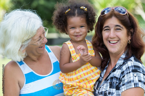 Hispanic grandma, mother and small daughter
