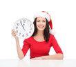woman in santa helper hat with clock showing 12