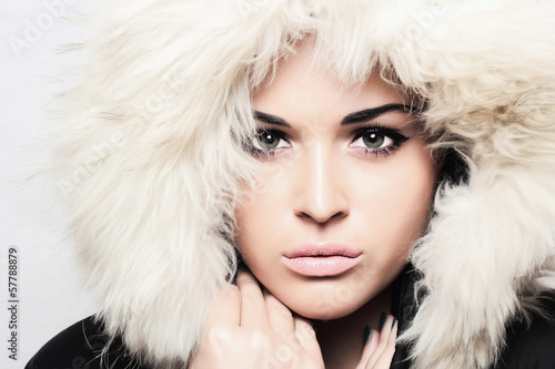 young beautiful woman with fur. white fur hood. winter style