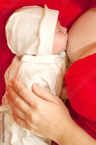 Baby breastfeeding. The newborn period.