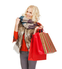 teenage girl in winter clothes with shopping bags