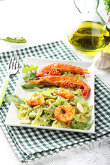 Pasta with red prawns and rocket pesto with almonds