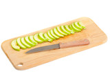 sliced green apple and steel knife on a Wood chopping board