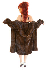 young sexy red-haired girl wearing underwear and  mink fur coat
