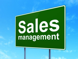 Marketing concept: Sales Management on road sign background
