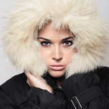 Beautiful woman with fur. white hood. winter style.make-up