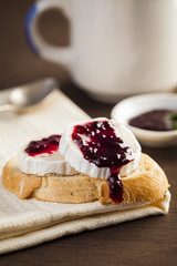 Bread with cheese and blackberry jam