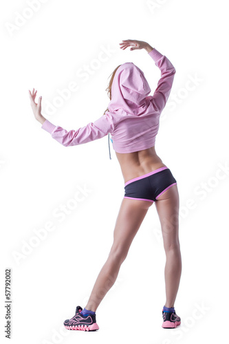 Slim muscular woman posing back to camera