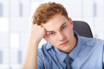 Young man while thinking