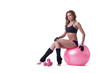 Confident slim woman posing with sport equipment