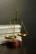 Gold scales of justice and folders on grey background