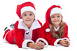 Kids in santa costumes at christmas time