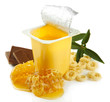 Tasty dessert in open plastic cup and honey combs, isolated