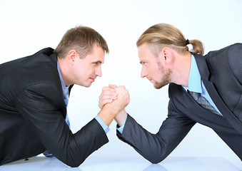 Arm wrestling of business people isolated on white