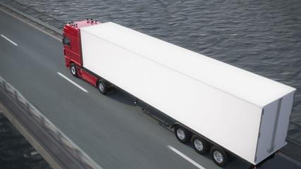 truck driving along a bridge revealing its load