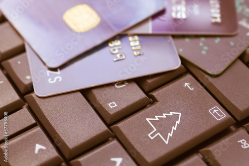credit cards on keyboard, enter christmas - e-commerce concept