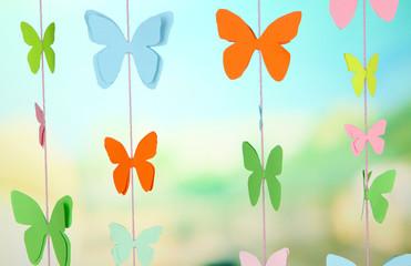Handmade paper garland on bright background