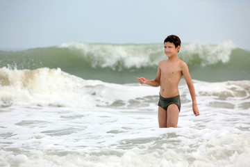 boy in waves in ocean