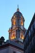Malaga cathedral tower illuminated at dusk. Andalusia, Spain