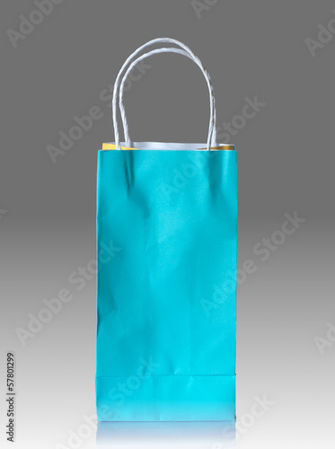 paper bag on reflect floor and gray background