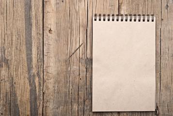 brown blank note book on grunge wood
