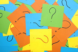 pile of colorful sticky notes with question marks symbolizing id