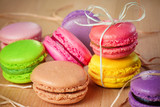 traditional french colorful macarons with a bow poster