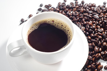 Cup of coffee with bean on white background