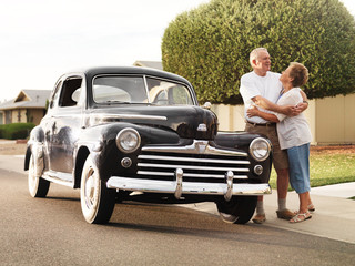 senior couple with vintage car