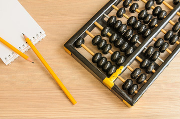 Ancient Chinese abacus,notebook,pencil