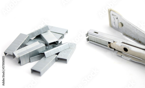 Stapler and staples isolated on white
