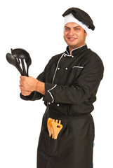 Chef male showing kitchen utensils
