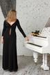 beautiful young woman playing piano