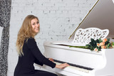 young woman playing the white piano