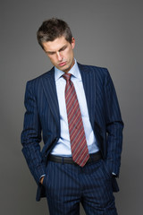 Elegant tired businessman looking down