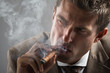 hard gaze businessman while smoking a cuban cigar