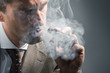 elegant adult man in a cloud of smoke