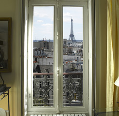 France - Paris - Window with Eiffel tower and roofs view