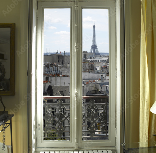 France - Paris - Window with Eiffel tower and roofs view - 57808473